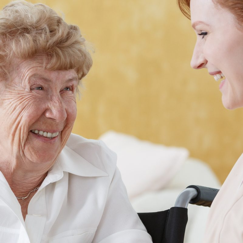 Older woman talking with caretaker