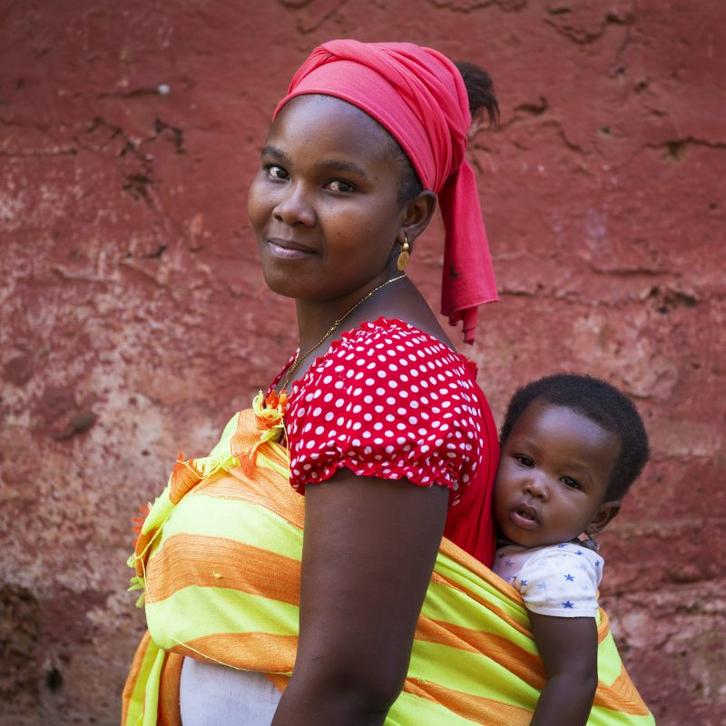 African woman with baby on back